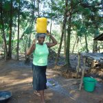 The Water Project: Maondo Community, Ambundo Spring -  Carrying Water