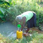 The Water Project: Maondo Community, Ambundo Spring -  Filling Container