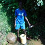 The Water Project: Rosterman Community, Lishenga Spring -  Boy At The Spring