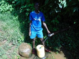 The Water Project:  Boy At The Spring