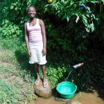 The Water Project: Rosterman Community, Lishenga Spring -  Waiting For Water At The Spring