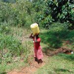 The Water Project: Jivovoli Community, Magumba Spring -  Carrying Water Home