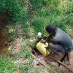 The Water Project: Jivovoli Community, Magumba Spring -  Fetching Water