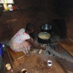 The Water Project: Jivovoli Community, Magumba Spring -  Girl Cooking Meal