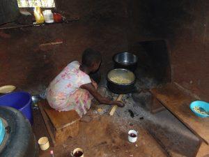 The Water Project:  Girl Cooking Meal