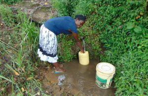 The Water Project:  Beatrice Mukhola Fetching Water