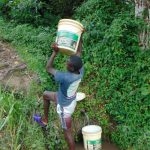 The Water Project: Buyangu Community, Mukhola Spring -  Carrying Water