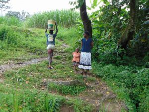 The Water Project:  Carrying Water From Spring