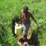 The Water Project: Emmachembe Community, Magina Spring -  Carrying Water Home
