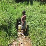 The Water Project: Emmachembe Community, Magina Spring -  Collecting Water