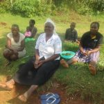 The Water Project: Emmachembe Community, Magina Spring -  Community Members Sitting Together