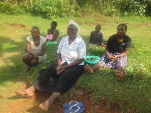 The Water Project:  Community Members Sitting Together