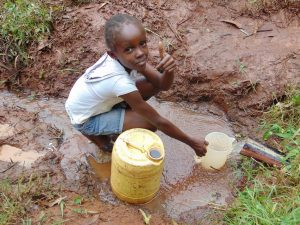The Water Project:  Child Collects Water