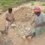 The Water Project: Kangalu Community -  Sorting Rocks
