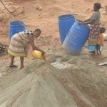 The Water Project: Kangalu Community A -  Mixing Cement