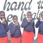 The Water Project: AIC Kyome Girls' Secondary School -  Drinking Water From The Tank