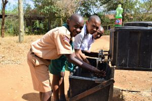 The Water Project:  Students Use Handwashing Station