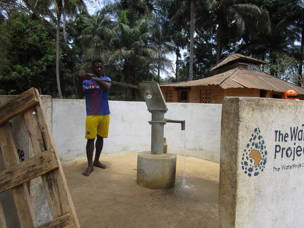The Water Project : sierraleone18249-community-member-using-water-source