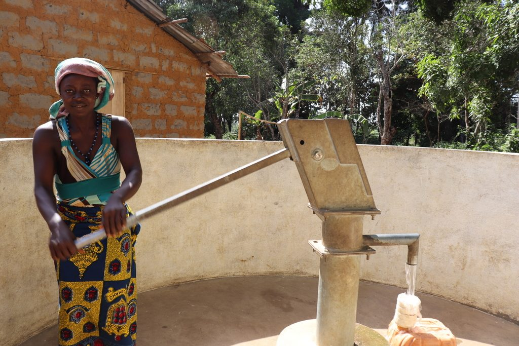 The Water Project : sierraleone18250-community-member-using-water-source