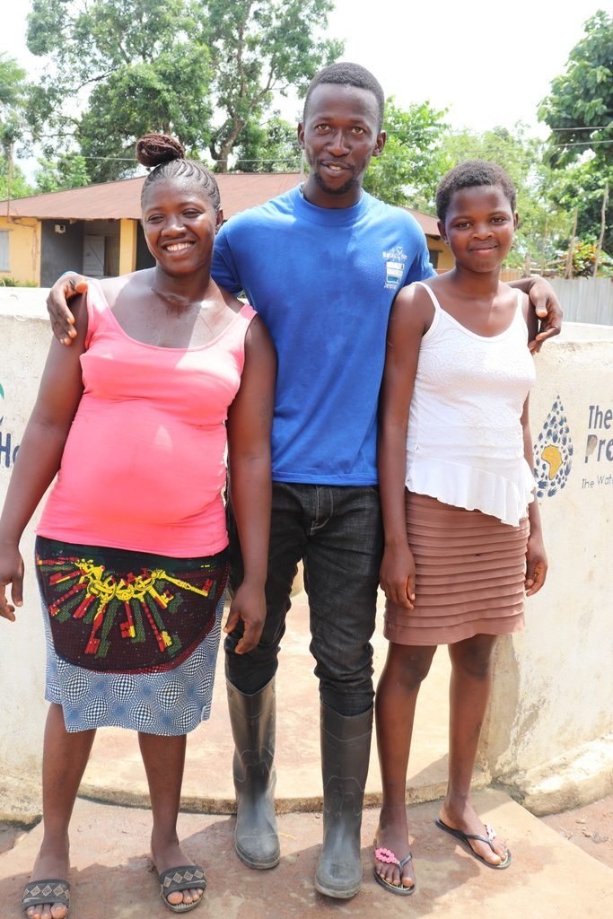 The Water Project : sierraleone18253-staff-with-community-members