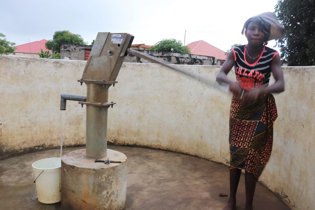 The Water Project : sierraleone18254-community-member-using-water-source