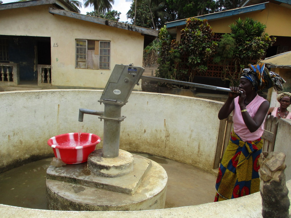 The Water Project : sierraleone18259-community-member-using-water-source