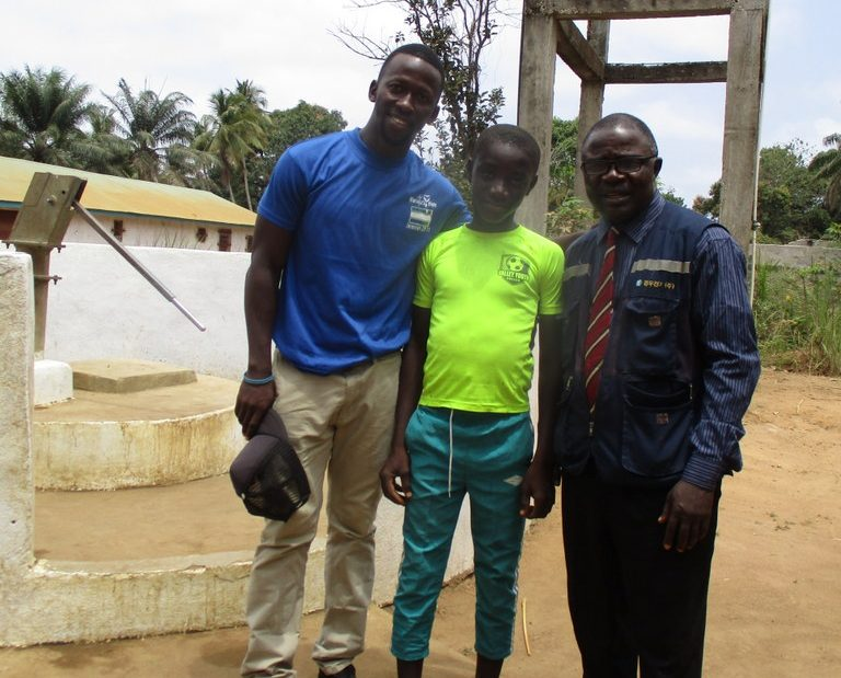 The Water Project : sierraleone18274-staff-with-the-two-interviewed-people