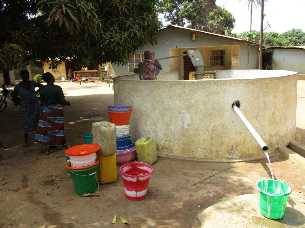 The Water Project : sierraleone18275-community-member-using-water-source