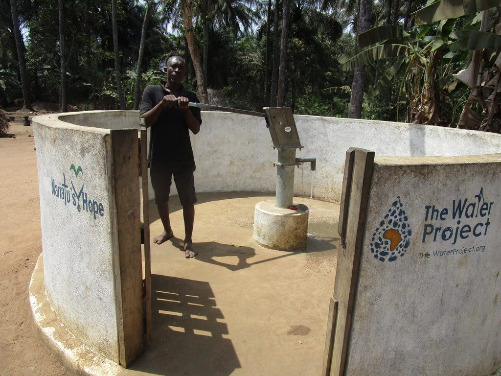 The Water Project : sierraleone18276-community-member-using-water-source