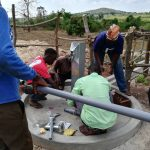 The Water Project: Kikube Nyabubale Community -  Installing The Pump