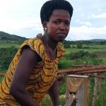 The Water Project: Kikube Nyabubale Community -  Mrs Grace Rukara Pumps The Well