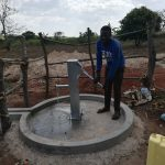 The Water Project: Kikube Nyabubale Community -  Pumping Water At The Well