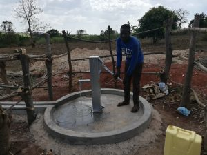 The Water Project:  Pumping Water At The Well