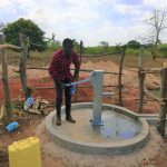 The Water Project: Kikube Nyabubale Community -  Water Flowing
