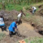 The Water Project: Shihungu Community, Shihungu Spring -  Excavation Begins To Divert The Water