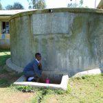 The Water Project: St. John Cheptech Secondary School -  Student At The Rain Tank