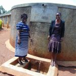 The Water Project: Shitaho Community School -  Head Teacher Mrs Jane Lodeki With Field Officer Rose Serete At The Rain Tank
