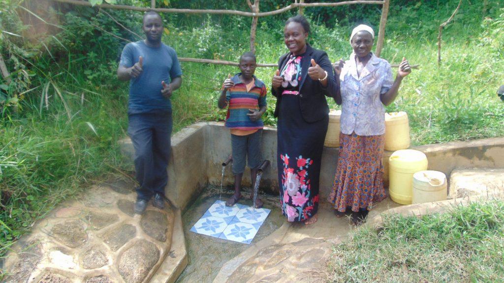 The Water Project : 1-kenya18120-water-committee-secretary-tom-mukonye-matayo-shivonje-field-officer-karen-maruti-joyce-mutachi-water-commitee-member