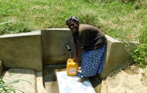 The Water Project:  Margaret Mukavana Fetches Water