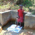 The Water Project: Mungaha B Community, Maria Spring -  Danstone Ochanji Gives Thumbs Up For Clean Water