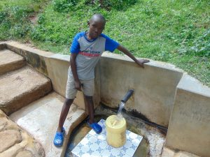 The Water Project:  Silas Okumu Fetches Water
