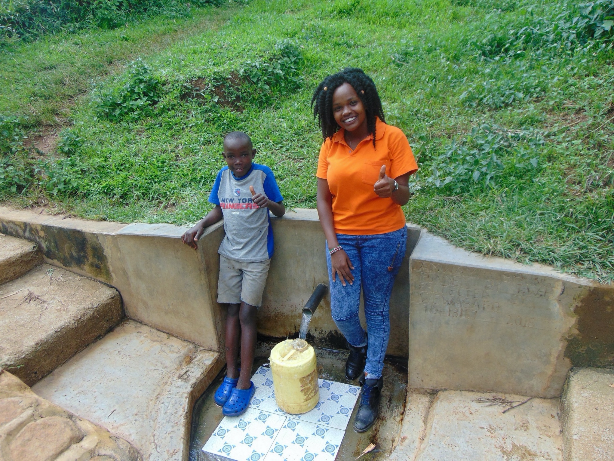 The Water Project : 1-kenya18147-silas-okumu-with-field-officer-georgina-kamau