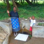 The Water Project: Lunyi Community, Fedha Mukhwana Spring -  Mama Judith Nyongesa With A Little Boy At The Spring