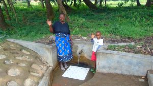 The Water Project:  Mama Judith Nyongesa With A Little Boy At The Spring