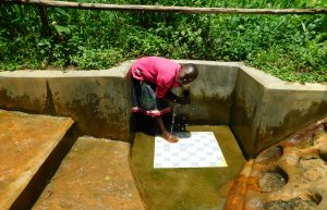 The Water Project:  Shaline Jeruto Getting A Drink From The Spring