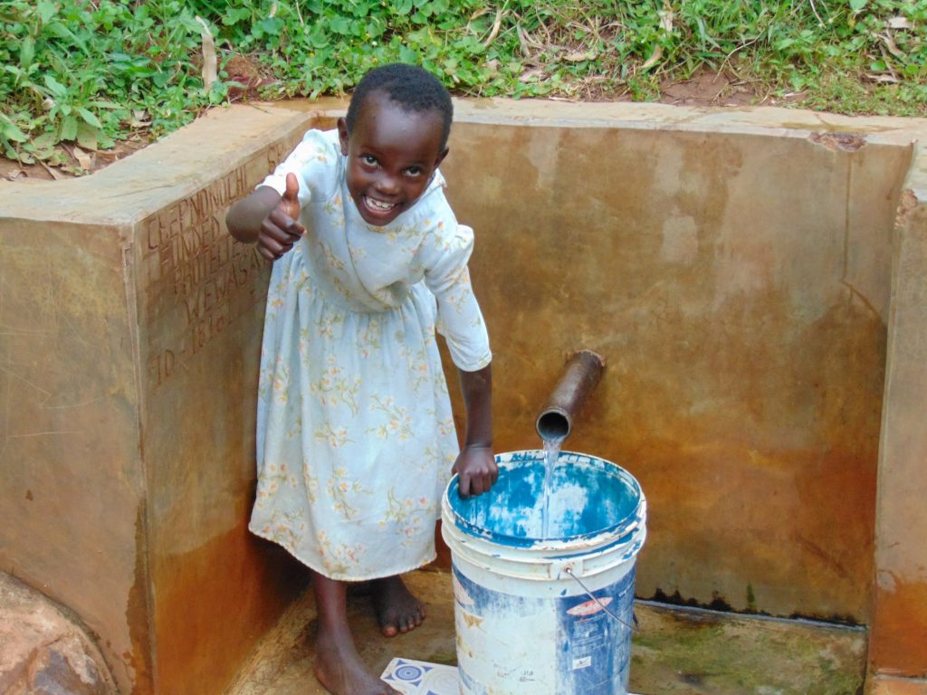 The Water Project : 1-kenya18161-sarah-edel-gives-a-thumb-sup-while-fetching-water