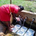 The Water Project: Irumbi Community, Shatsala Spring -  Field Officer Karen Maruti At The Spring