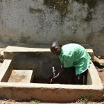 The Water Project: Mukunyuku RC Primary School -  Student At The Rain Tanks Tap