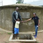 The Water Project: Ikoli Primary School -  Field Officer Betty Mwanji Shakes Hands With Student Cheinster