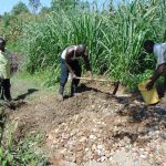 The Water Project: Shihungu Community, Shihungu Spring -  Mixing Concrete